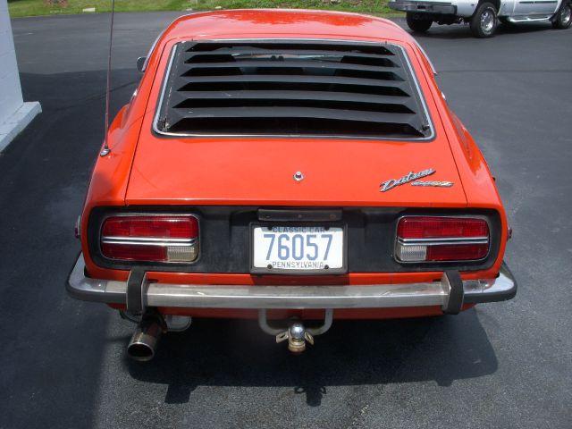 1973 Datsun 120 2004 Jeep Sport