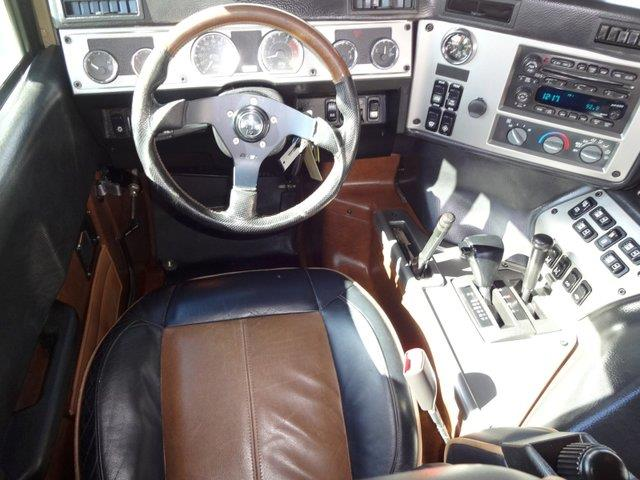 2006 Hummer H1 2004 Dodge SXT