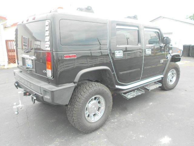 2004 Hummer H2 Scion XB