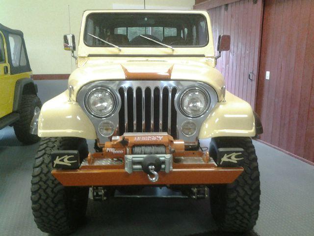 1983 Jeep Scrambler CJ8 2010 Cadillac CTS